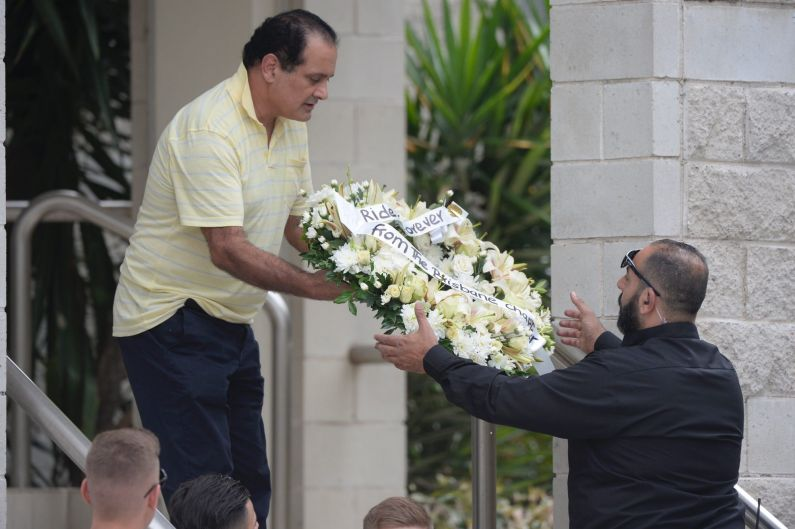 Flowers arrive at Mick Hawi's funeral.