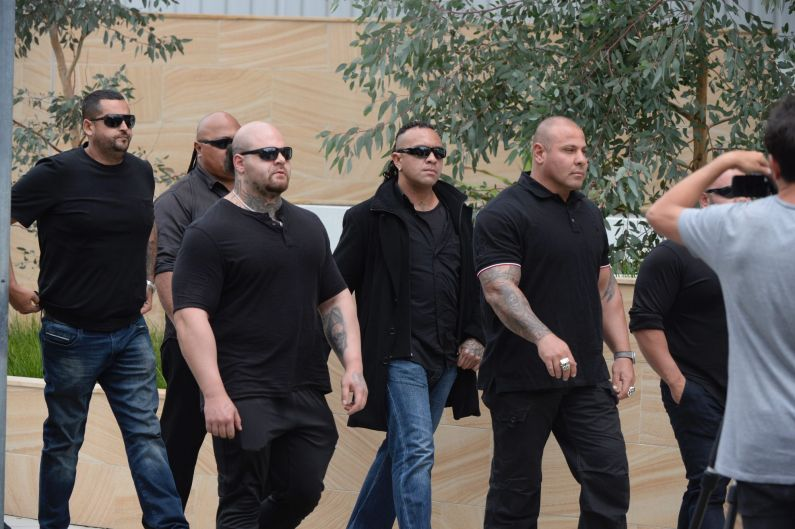 Mourners arrive at Mick Hawi's funeral.