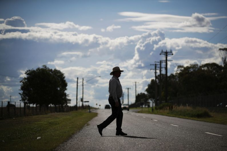Then candidate for New England, Barnaby Joyce crossing the road back to his car after posing for portraits at the ...