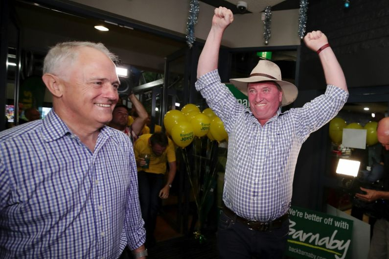 Prime Minister Malcolm Turnbull and New England candidate Barnaby Joyce celebrate at Barnaby Joyce's election night ...