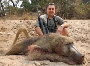 Nick Haridemos with the same baboon killed on a hunting trip to Zimbabwe in 2014.