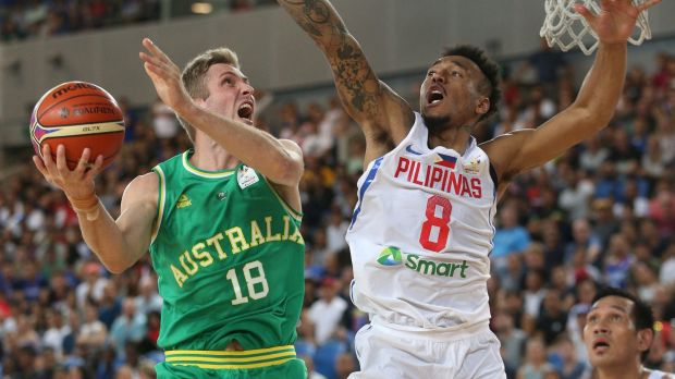 Jesse Wagstaff attempts to score under pressure from Calvin Abueva of Philippines during the FIBA World Cup qualifier ...