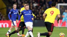 Everton's Wayne Rooney kicks the ball past Watford's Troy Deeney during their English Premier League match at Vicarage ...