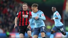 Bournemouth's Dan Gosling, left, and Newcastle United's Dwight Gayle vie for the ball during their Premier League soccer ...