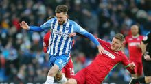 Brighton & Hove Albion's Davy Propper is challenged by Swansea City's Alfie Mawson during their English Premier League ...
