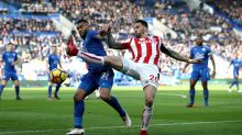 Leicester City's Danny Simpson, left, and Stoke City's Geoff Cameron challenge for the ball during the English Premier ...