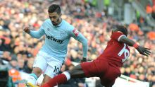 West Ham's Manuel Lanzini, left, and Liverpool's Sadio Mane battle for the ball during the English Premier League soccer ...