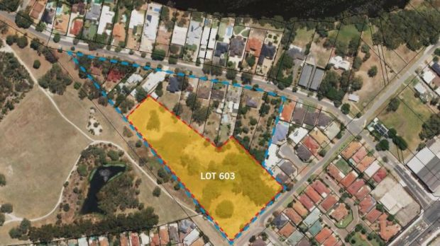 Lot 603 (red outline) within Development Area 8 (blue outline).