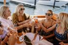 Nadia Fairfax, Jasmine Yarbrough, Deborah Symond and Montarna McDonald arrive by yacht at a lunch to celebrate the ...
