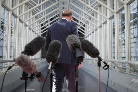 Minister for Home Affairs Peter Dutton departs after addressing the media during a doorstop interview at Parliament ...