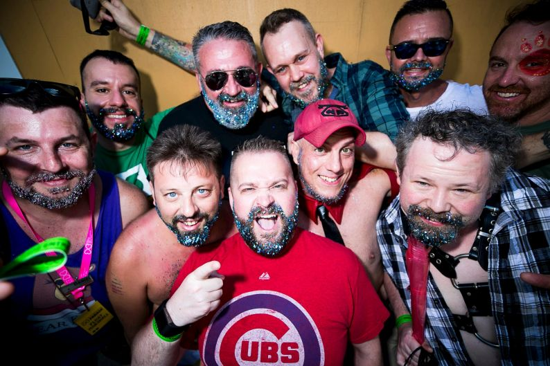 "With beards glittered, a group of ""Bears and Cubs""get ready to march."