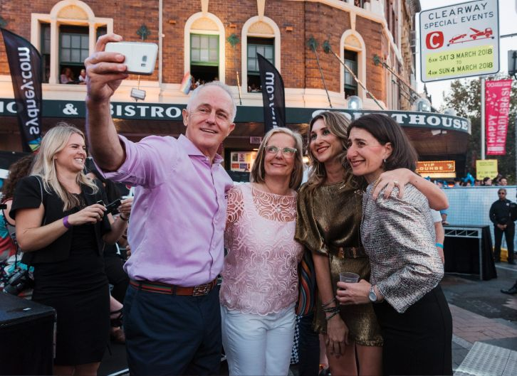 Prime Minister Malcolm Turnbull, wife Lucy Turnbull and NSW NSW Premier Gladys Berejiklian stop for selfie.