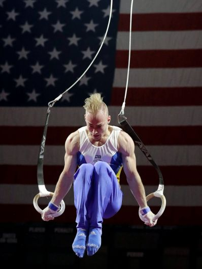 Petro Pakhniuk, of Ukraine, competes on the still rings during the American Cup gymnastics competition in Hoffman ...
