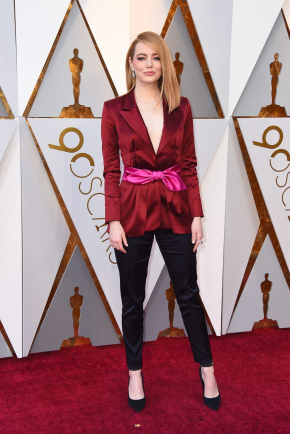Emma Stone arrives at the Oscars on Sunday, March 4, 2018, at the Dolby Theatre in Los Angeles.