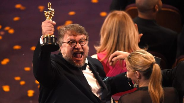"Guillermo del Toro, winner of the award for best director for ""The Shape of Water"" celebrates in the audience at the ..."