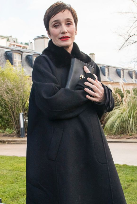Actress Kristin Scott Thomas poses for photographers after the Valentino ready-to-wear fall/winter 2018/2019 fashion ...