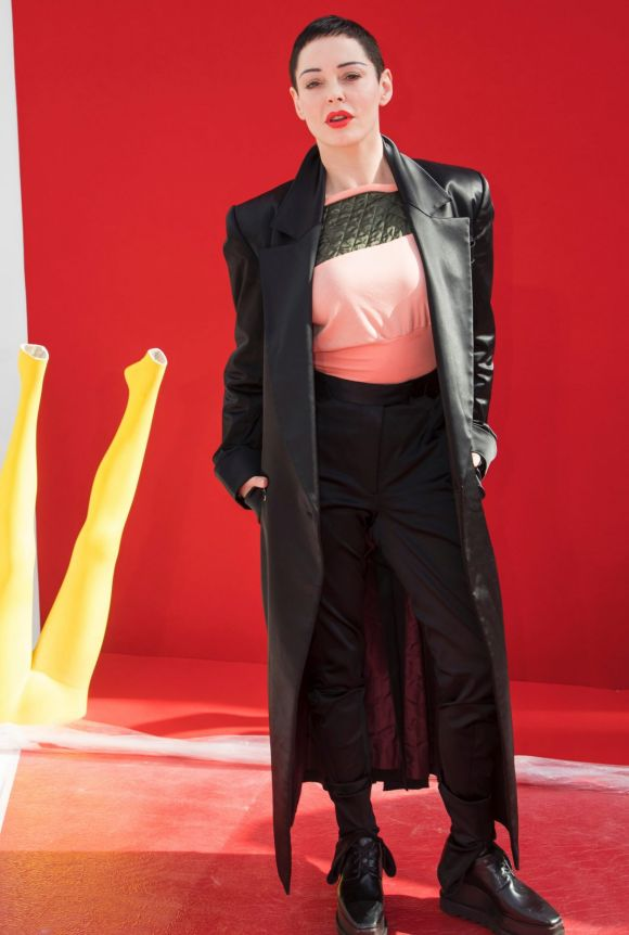 Actress Rose McGowan poses for photographers before the Andreas Kronthaler for Vivienne Westwood ready-to-wear ...