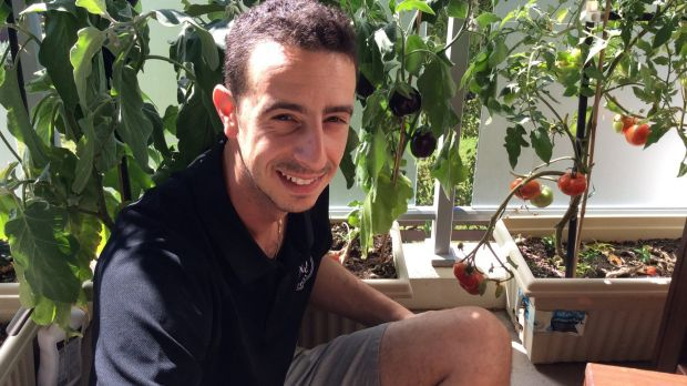 Dario Campagna with homegrown vegetables on his balcony in Phillip.