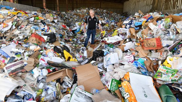 Chris Philp, general manager of Wheelie Waste, amongst a day's worth of Kyneton's recycle rubbish.