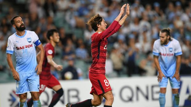 Shoma Doi (centre) of the Antlers reacts after scoring against Sydney during the AFC Champions League Group H match ...
