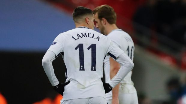 Tottenham's Erik Lamela and Harry Kane leave the field at Wembley.