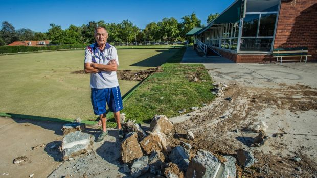 Bob Powell, president of the Canberra City Bowling Club, watched a bobcat tear up the green, marking the club's closure.