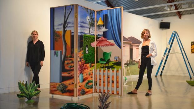 Megan Monte and Josephine Skinner standing in front of Amber Koroluk-Stephenson's  Somewhere in the Middle, at new ...