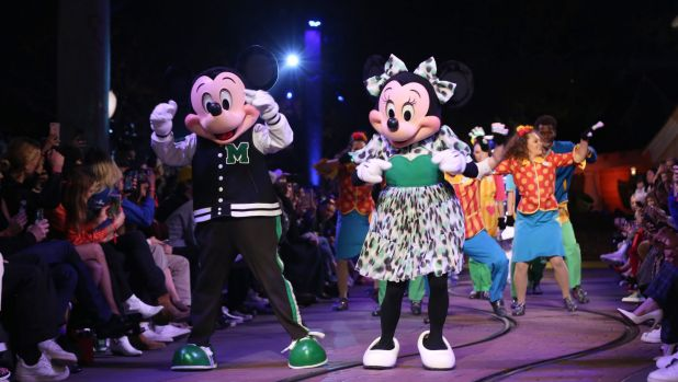 Disney's characters Mickey and Minnie Mouse walk down the runway at the Opening Ceremony Spring 2018 Collection Show.