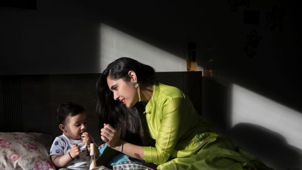 Ripal Shah with her 10 months old son Prayaan in her sister's Westmead apartment.