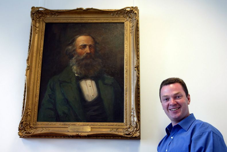 Christopher Pyne, Liberal Member for Sturt, SA with a painting in his office in Parliament House Canberra. Monday the ...