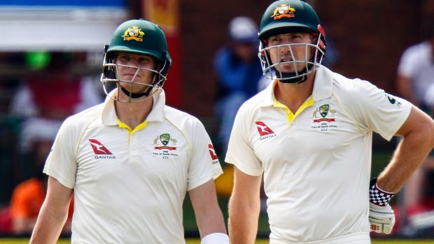 Steven Smith (left) with teammate Shaun Marsh, look on as the television umpires review his LBW appeal.
