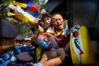 Indian para-military force soldiers push exiled Tibetan activists into a police bus during a protest outside the Chinese ...