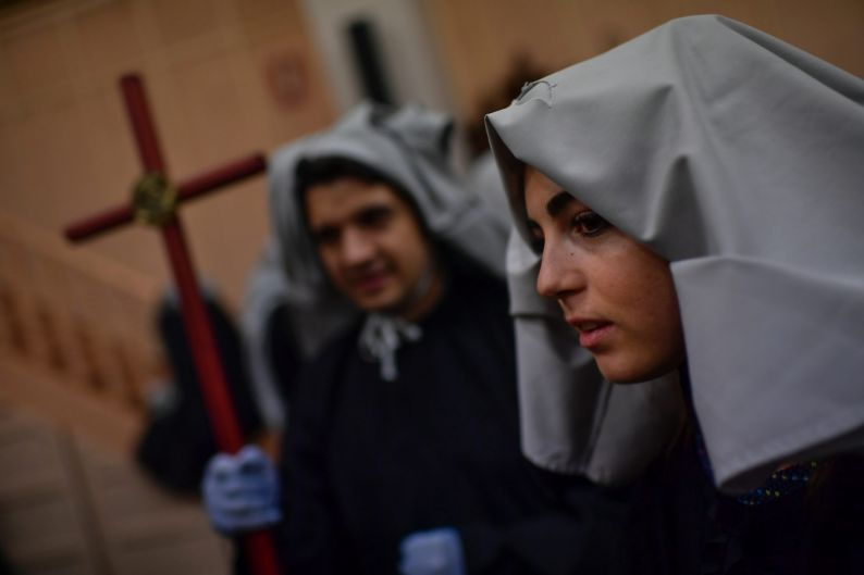 Young female penitents of the ''Hermandad del Senor'' brotherhood, prepare to take part in the traditional ''Cristo ...