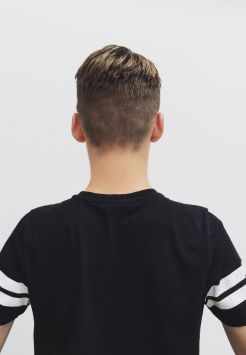 J0X1WW Rear view of a boy with a new haircut Generic Teenage boy with? haircut?