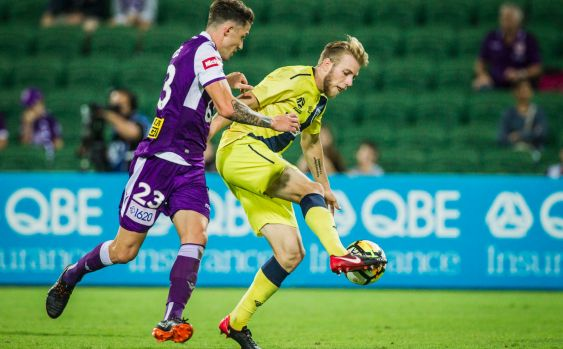 Scott Neville of the Perth Glory and Andrew Hoole of the Central Coast Mariners fight it out.