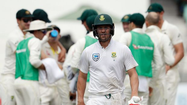 South Africa's batsman AB de Villiers leaves the field after being run out for a duck on day four of the first cricket ...