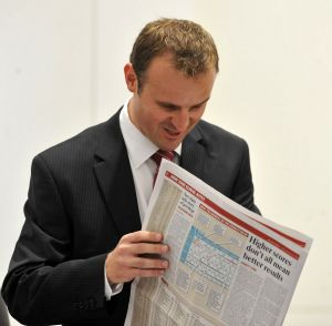In this file photo from 2010, then- education minister Andrew Barr refers to The Canberra Times education coverage in ...