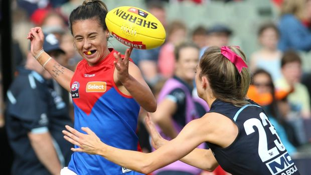 Tipping point: Demon Aliesha Newman comes under pressure from the Blues' Bridie Kennedy.