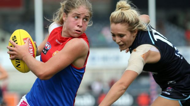 Cutting a dash: Melbourne's Katherine Smith shrugs off a tackle from Carltons's Jess Hosking.