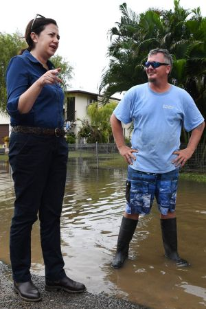 Ms Palaszczuk meets Nigel and Belinda Strong outside their flood-affected house.
