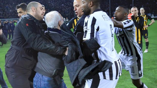 Armed and dangerous: Ivan Savvidis  confronts opposition players, while wearing a holster apparently containing a pistol.