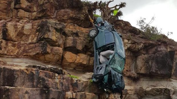 A recovery crew retrieves the car from the cliff at Point Arkwright at the Sunshine Coast.