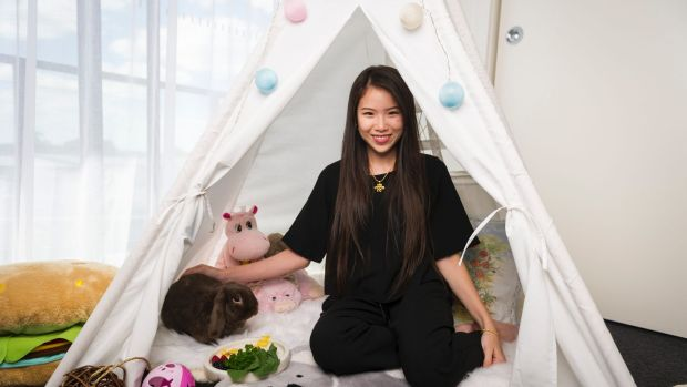 Cocobunbuns in his teepee with owner Sarah Pineda.