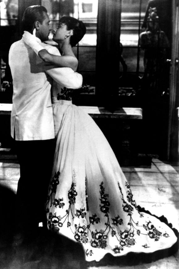 Audrey Hepburn wears Givenchy as she dances with William Holden in the 1954 film Sabrina.