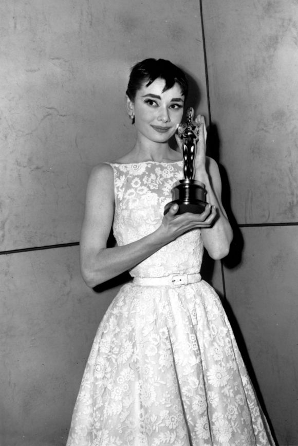Audrey Hepburn, in Givenchy, poses with her Best Actress statuette, won for her performance in Roman Holiday, at the ...