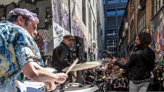 Aussie rockband Jet performing a pop up gig in AC/DC Lane as part of a tour announcement.