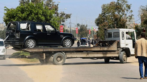 A damaged vehicle is removed from the scene of the blast that occurred as Hamdallah's convoy entered Gaza.