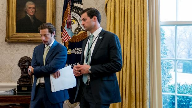 Former aide to Donald Trump, John McEntee, right, has left his role in the White House over a security issue.