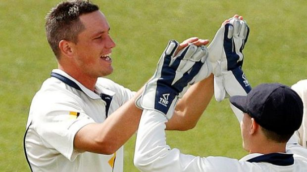 Chris Tremain celebrates dismissing Tasmania's Jordan Silk on day one of their Sheffield Shield match in Hobart.
