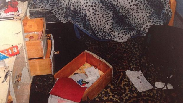 A bedroom also with drawers pulled out, to make it look like a burglary.